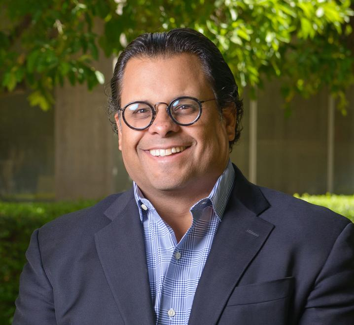 A professional headshot photo of Dr. Bryan Brayboy photographed on the ASU Tempe campus.